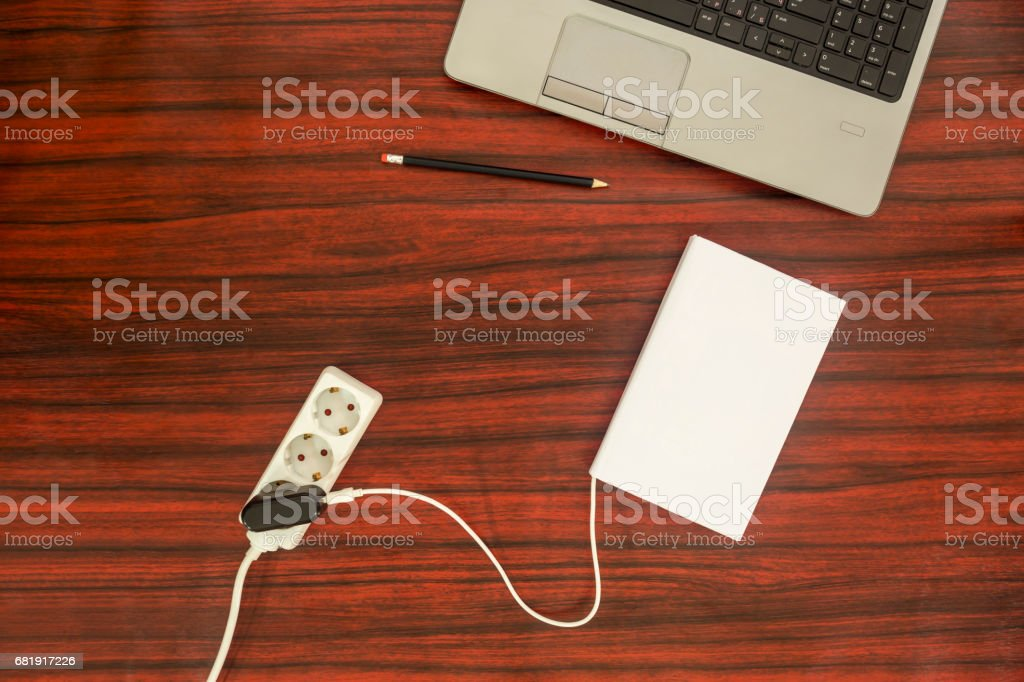 Book connected to a power outlet. stock photo