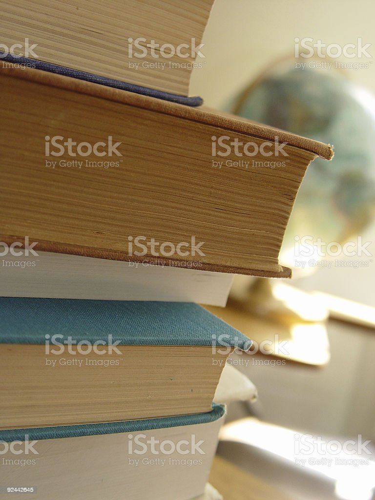 Book detail with globe and desk royalty-free stock photo
