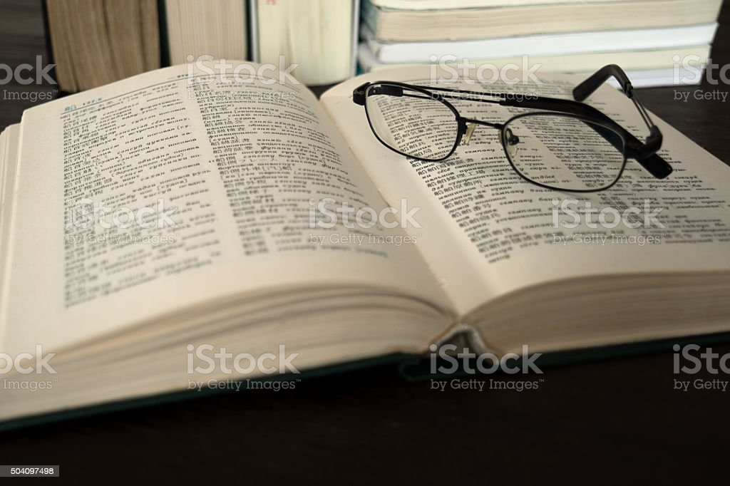 Book Dictionary Japanese Russian with glasses stock photo