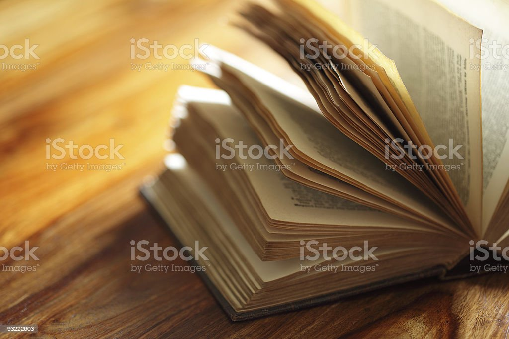 A book discarded on a table with the pages open stock photo