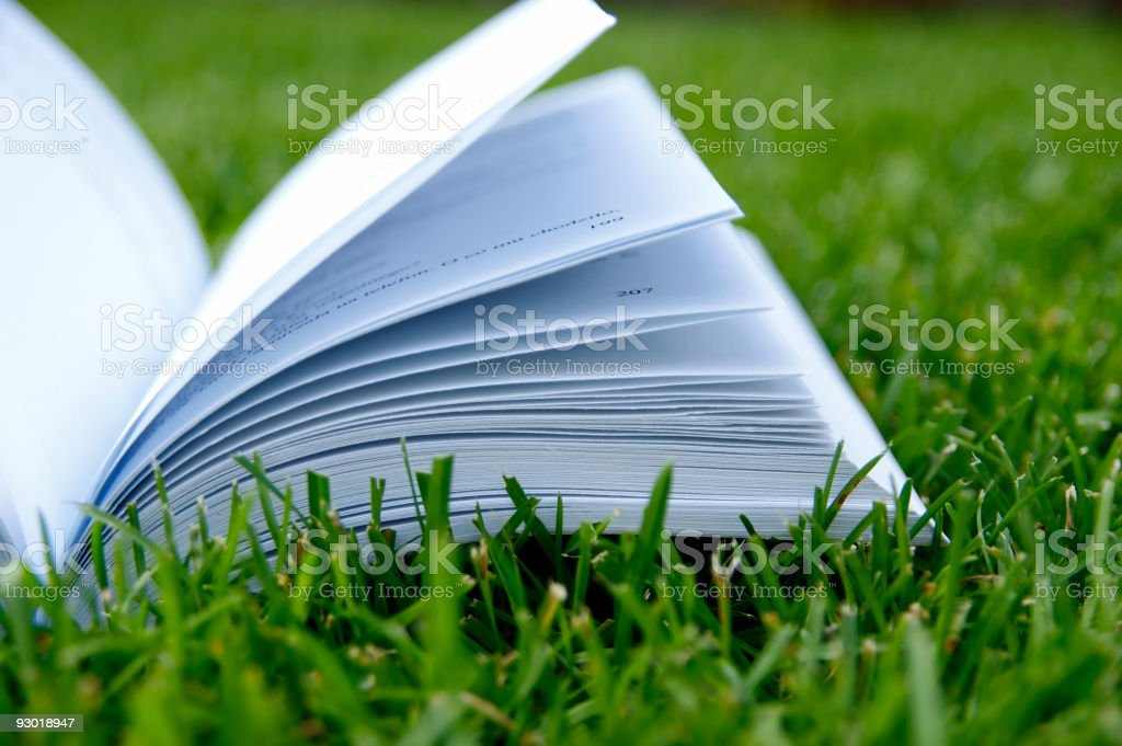 Book in the grass royalty-free stock photo