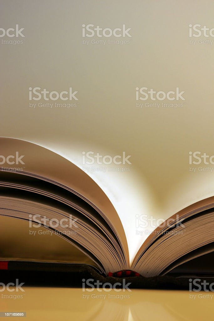 A book laying open with a blurred background stock photo