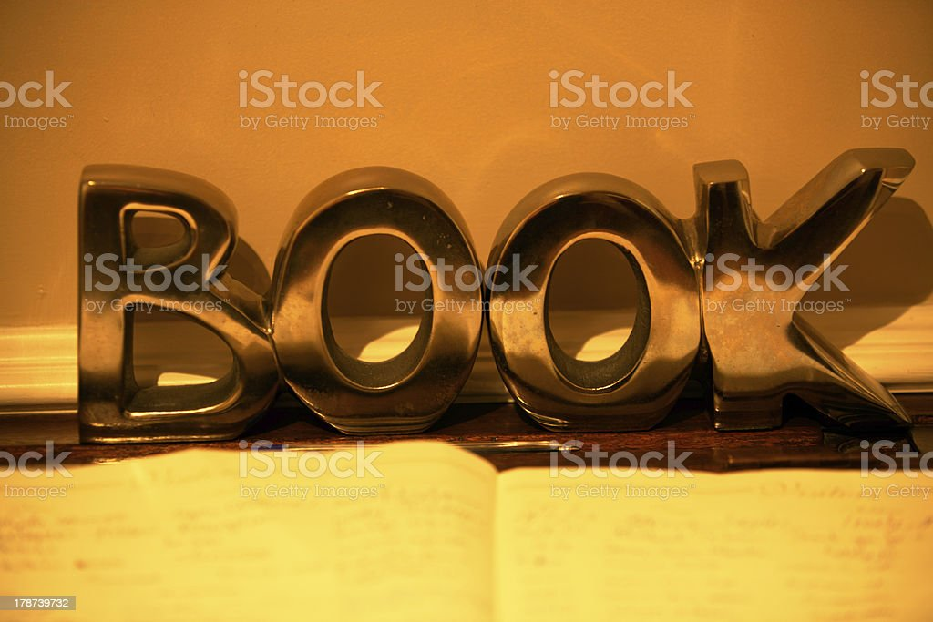 book letters in reflective gold royalty-free stock photo
