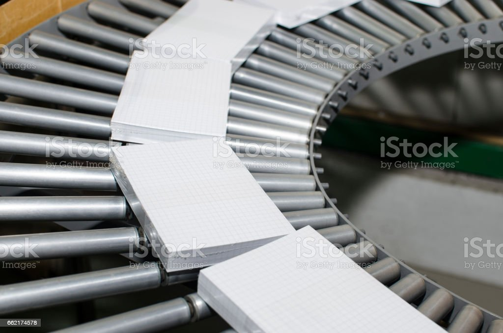 book, magazine production line into press plant house. Binding product stock photo
