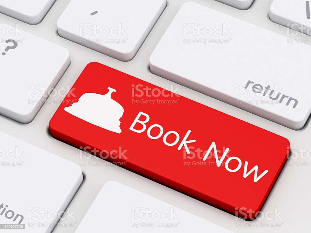 Book Now written on keyboard key stock photo