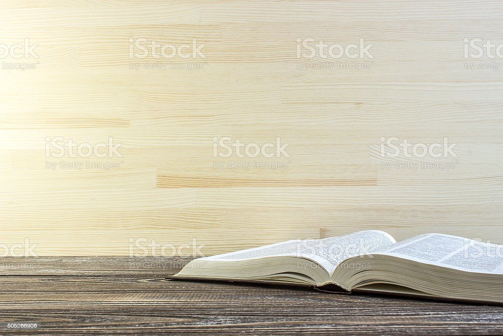 Book on a wooden table stock photo
