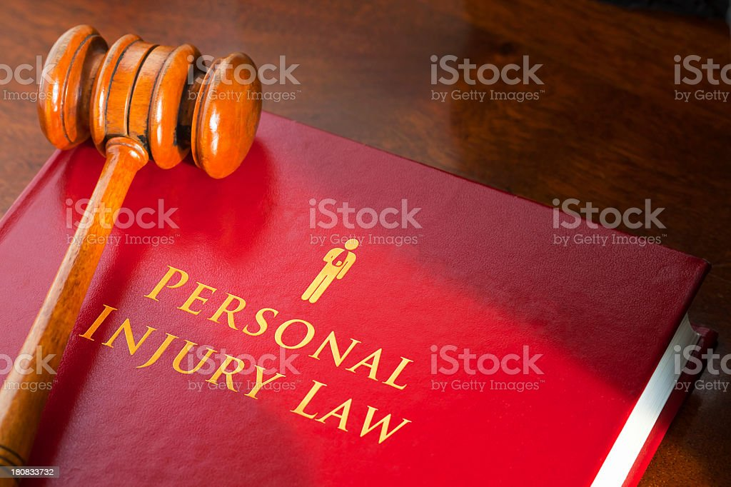 Book on personal injury law with a judge's gavel royalty-free stock photo