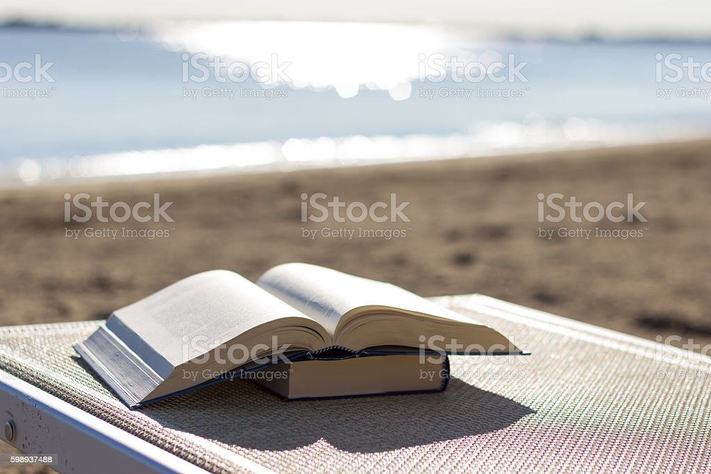 Book on the beach stock photo