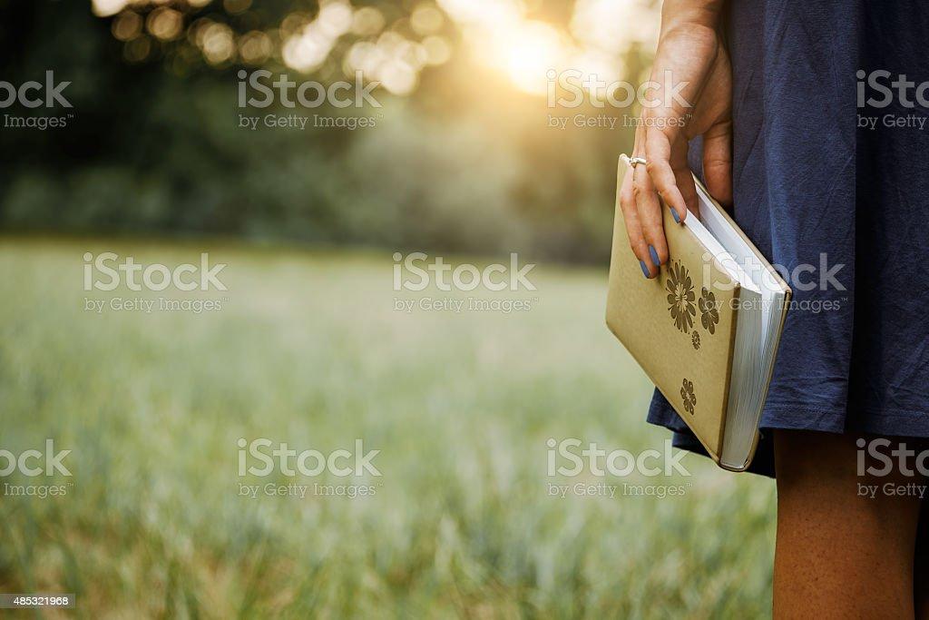 Book on women's hand stock photo