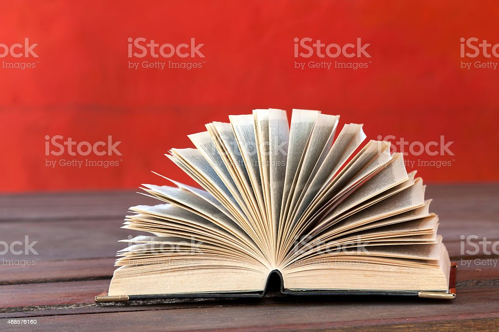 Book open and the red wall royalty-free stock photo