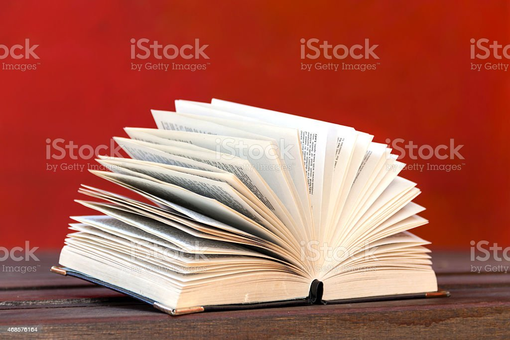 Book open with red background royalty-free stock photo