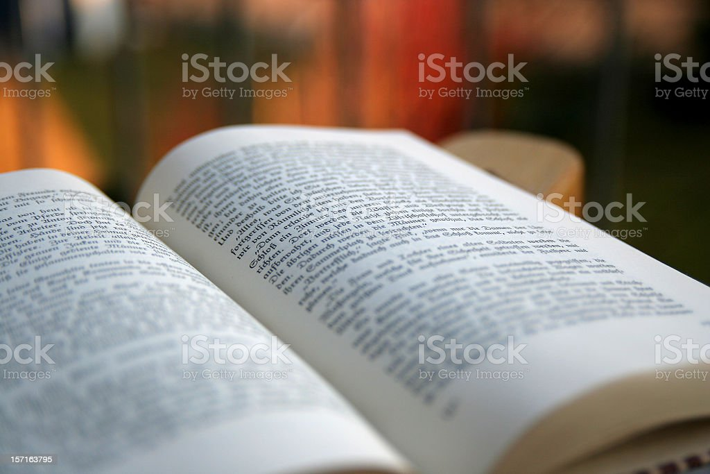 Book opened and out of focus with colorful background royalty-free stock photo