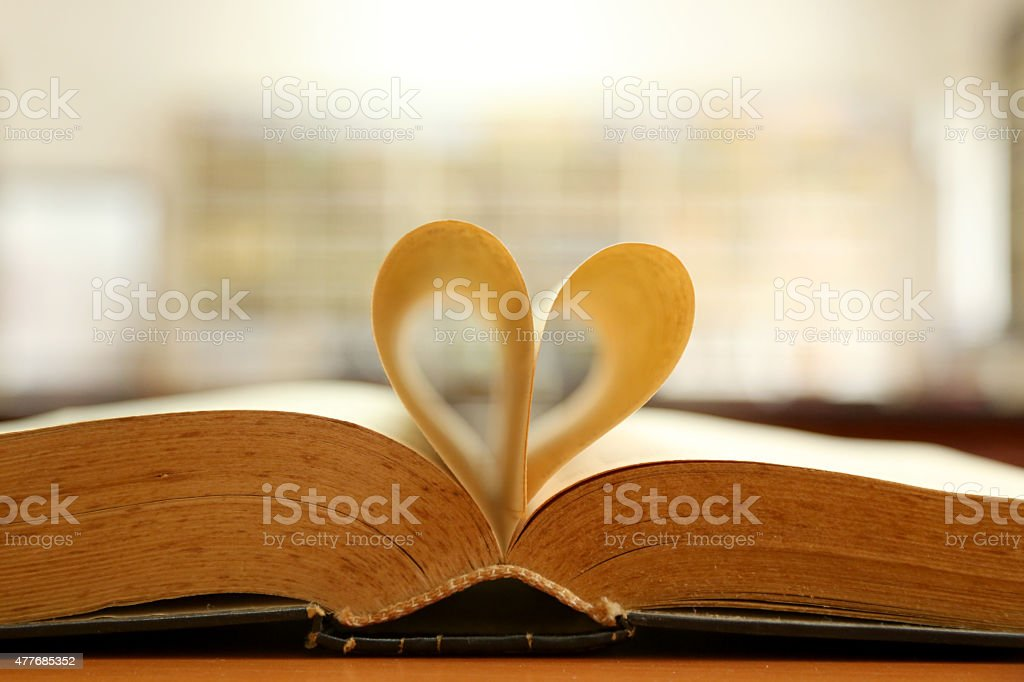 book pages forming heart stock photo