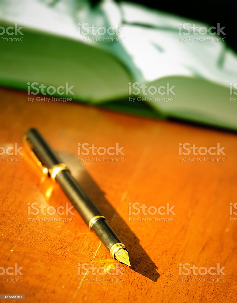 book, pen and glasses stock photo
