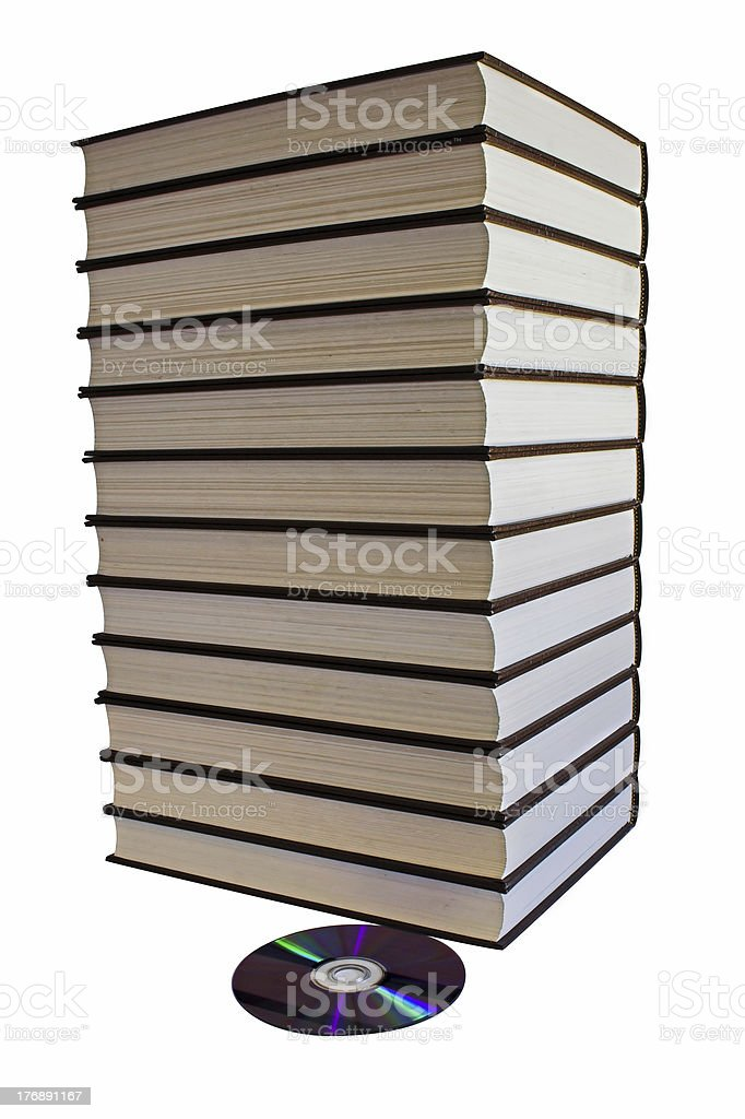 Book pile and one DVD disk stock photo