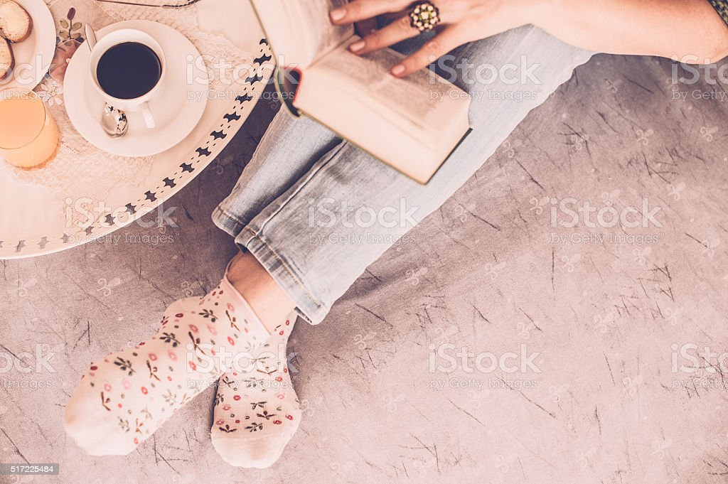 Book reading in bed stock photo