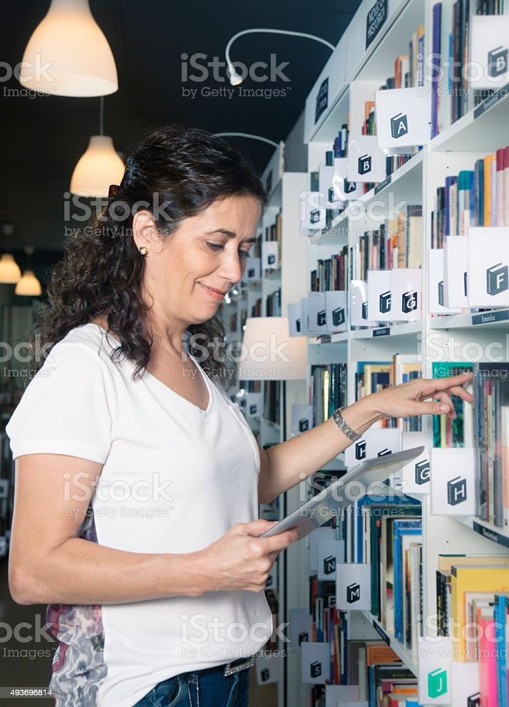 Book seller making inventory stock photo