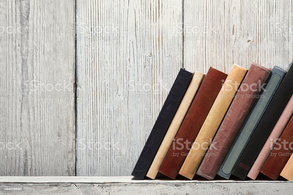 book shelf old blank covers spines, wood texture, knowledge concept stock photo