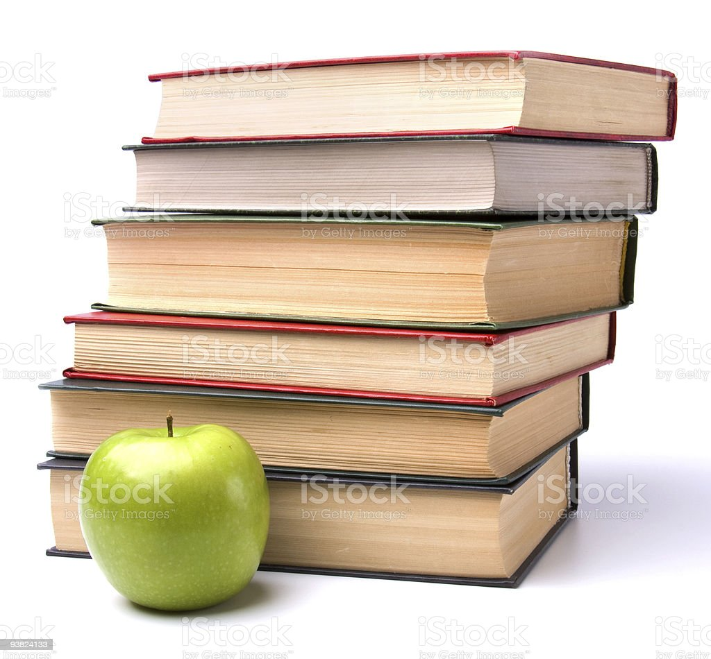 book stack and apple on white background royalty-free stock photo