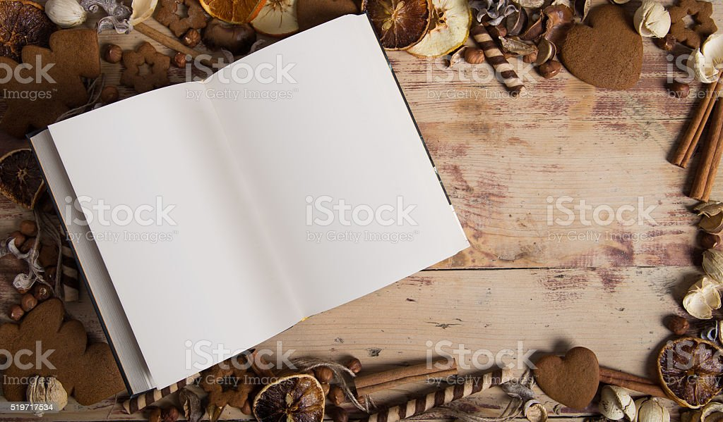 Book surrounded by festive decorations. stock photo