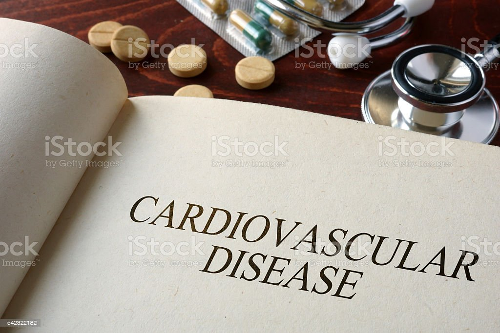 Book with diagnosis cardiovascular disease and pills. stock photo