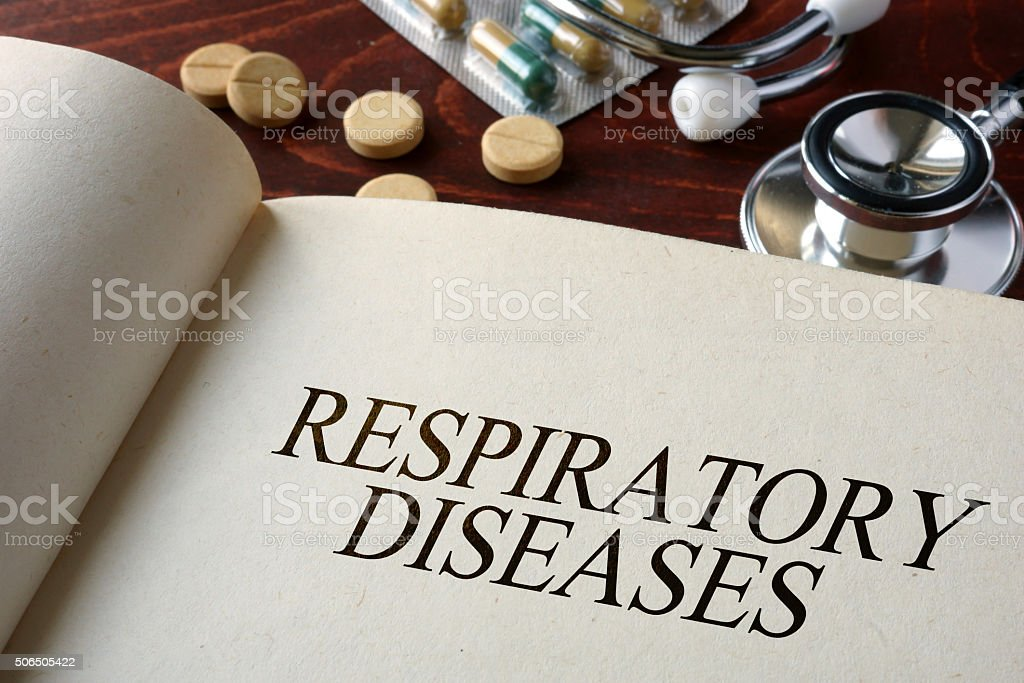 Book with diagnosis respiratory diseases and pills. Medical concept. stock photo