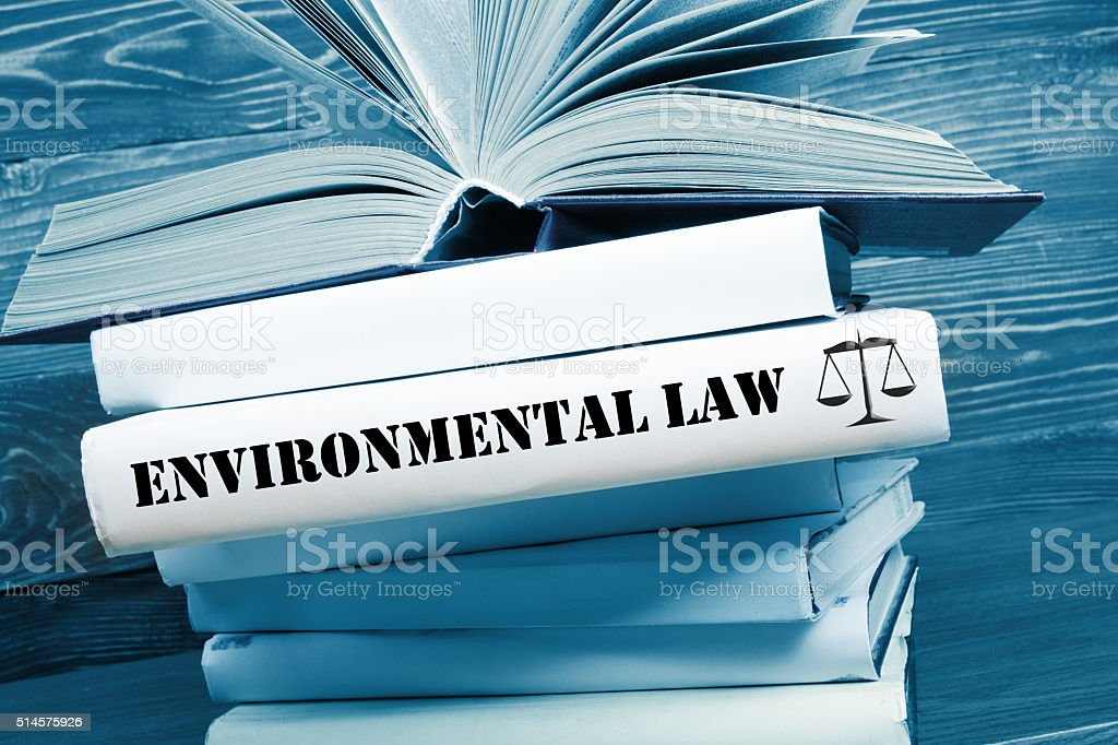 Book with Environmental Law word on table in a courtroom stock photo