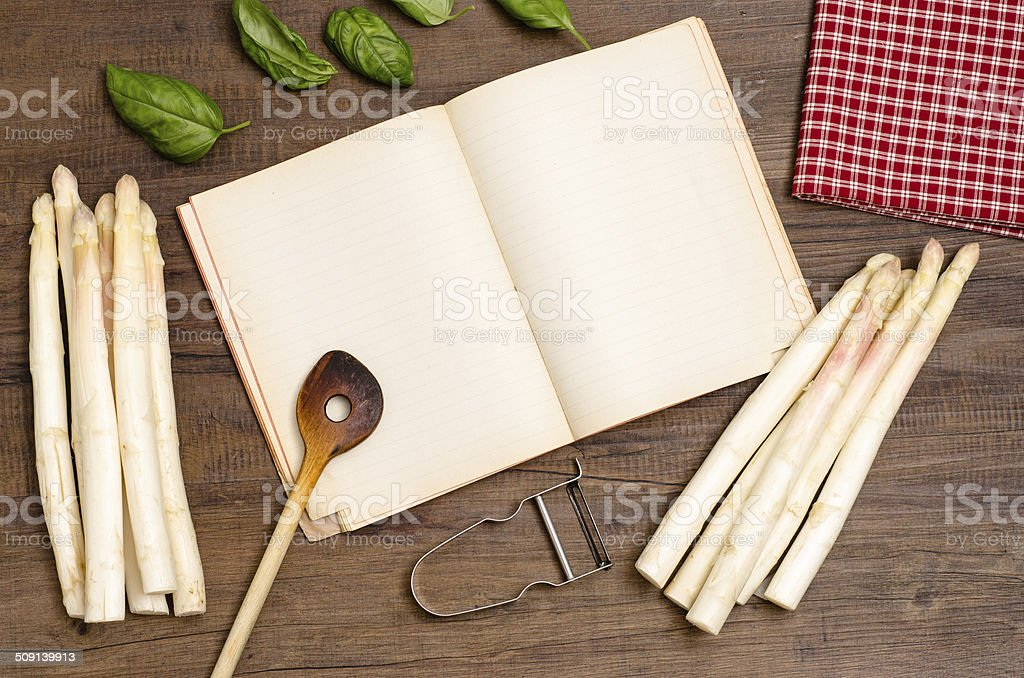 Book with free space and asparagus royalty-free stock photo
