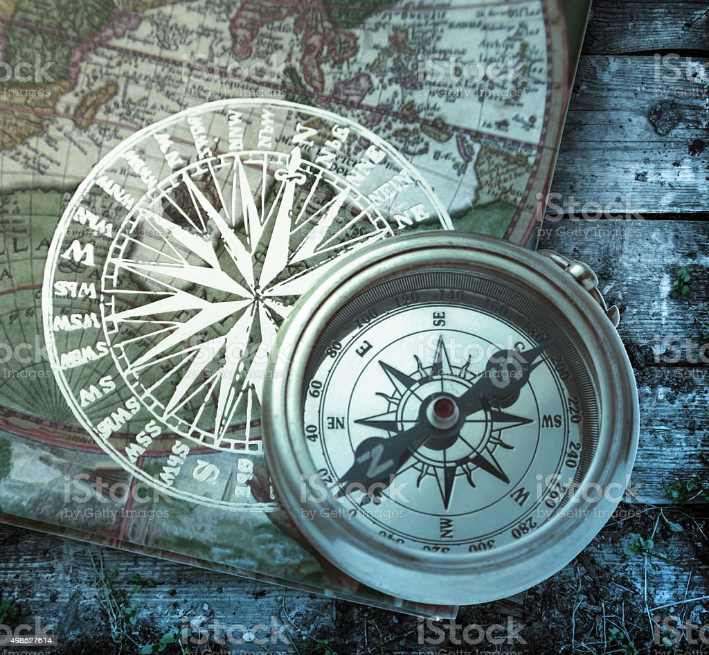 Book with retro compass on it stock photo