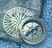 Book with retro compass on it