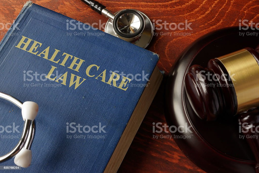 Book with title Health Care Law on a table. stock photo