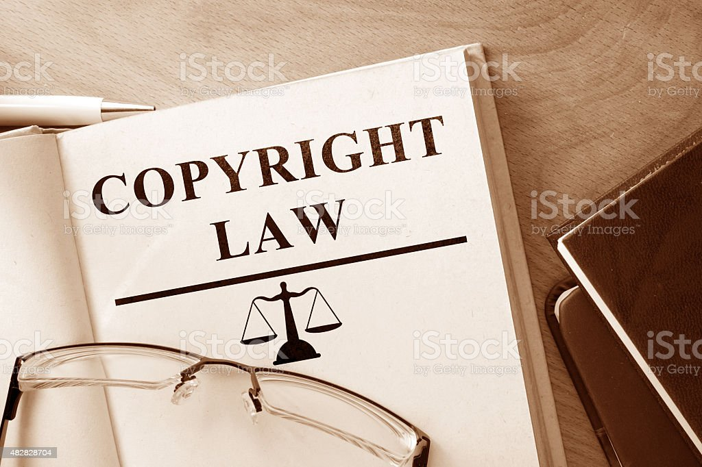 Book with words Copyright Law and glasses. stock photo