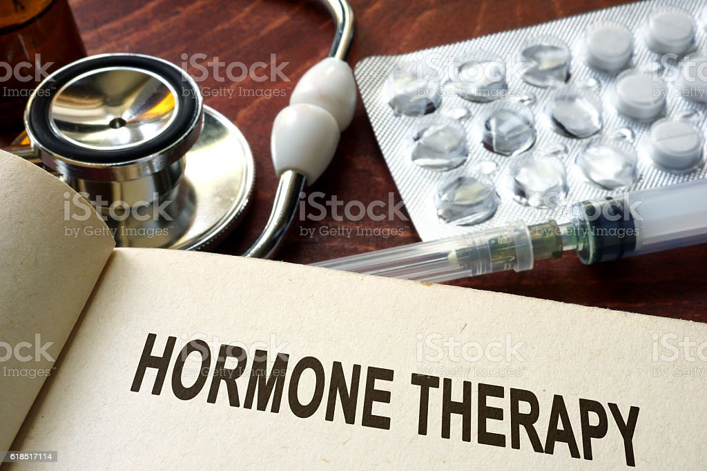 Book with words hormone therapy on a table. stock photo