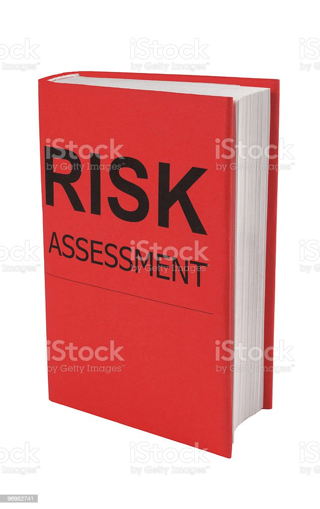 Book with words Risk Assessment on cover stock photo