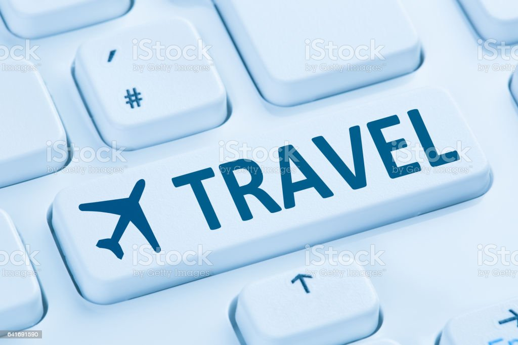 Booking flight holidays vacation travel online shop internet blue computer stock photo