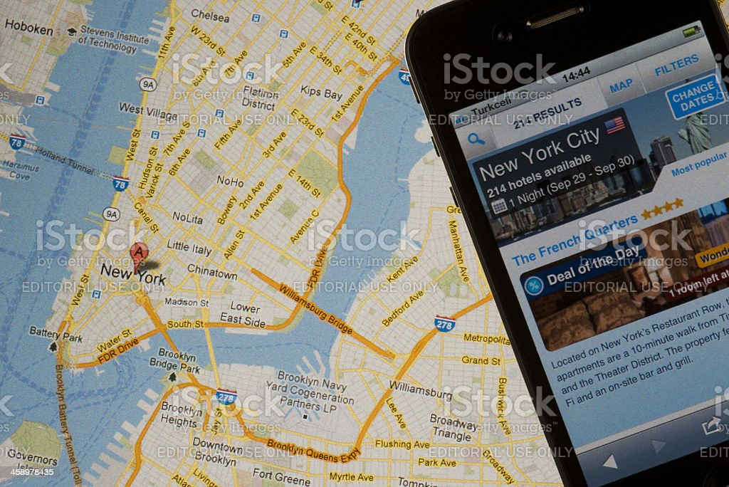 Booking.com website opened on iphone 4with stock photo