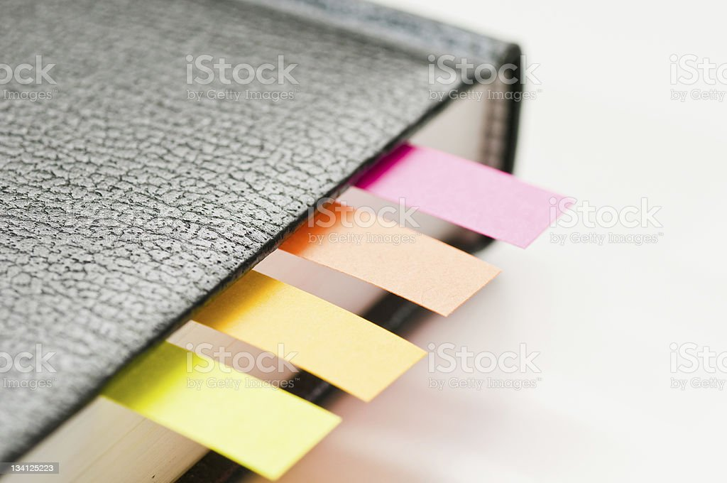Bookmarks between pages of hardcover book stock photo