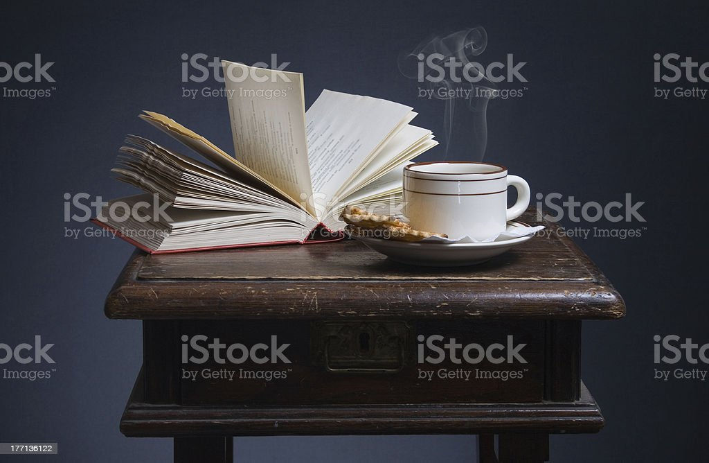 books and a cup of coffee stock photo