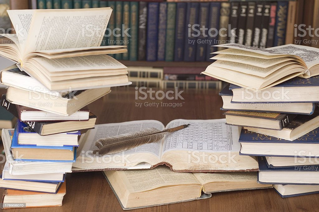 Books and a feather pen royalty-free stock photo