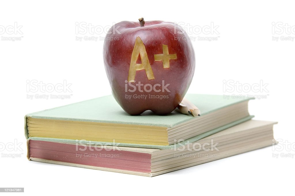 Books and A Plus Apple royalty-free stock photo