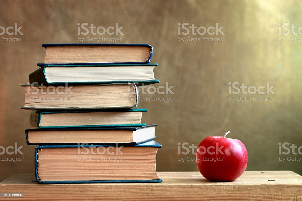 Books and apple stock photo