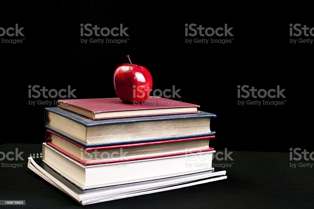 Books and apple with black background royalty-free stock photo