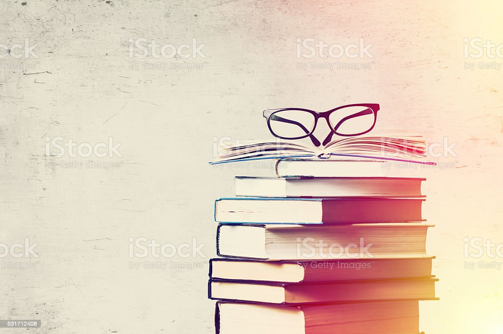 books and eyeglasses stock photo