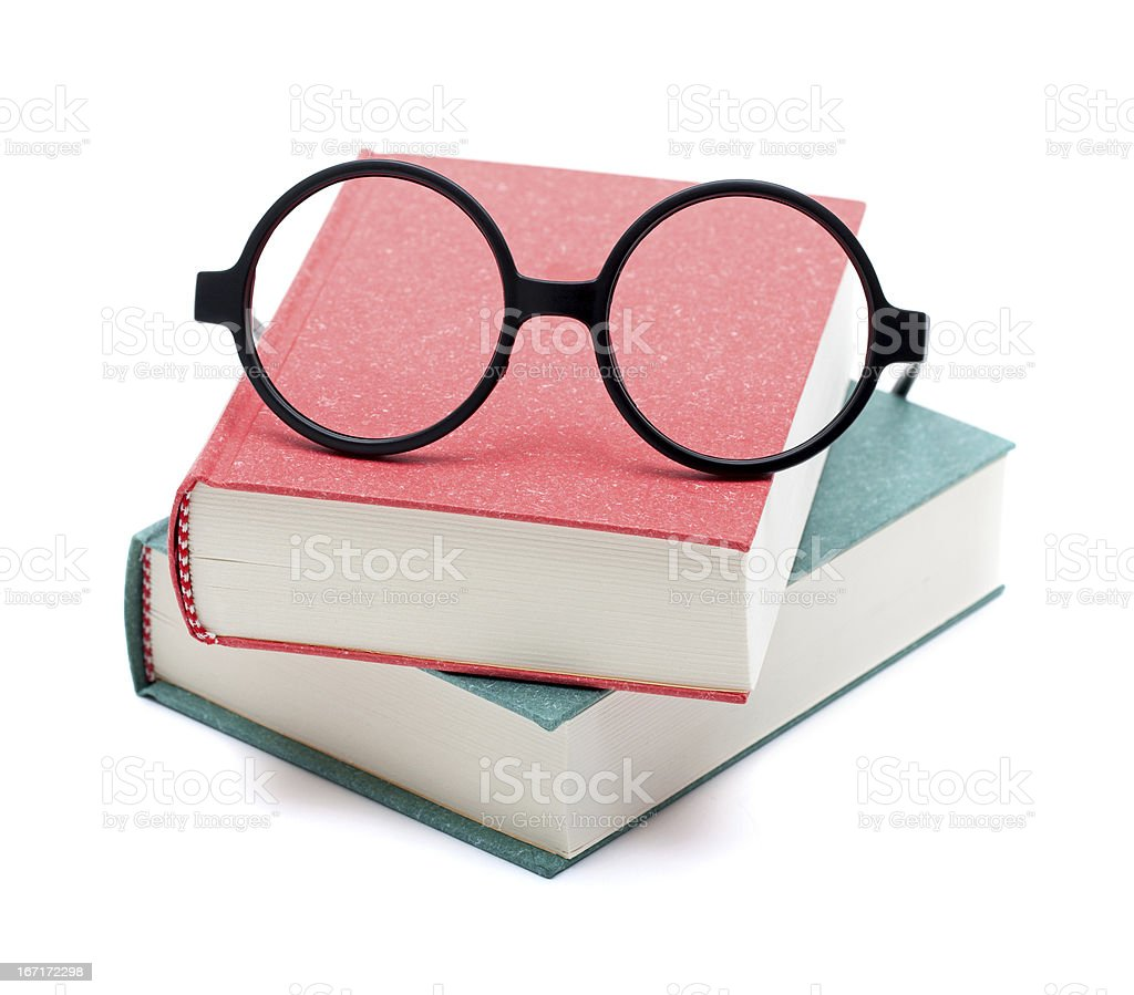 Books and glasses isolated on white background stock photo