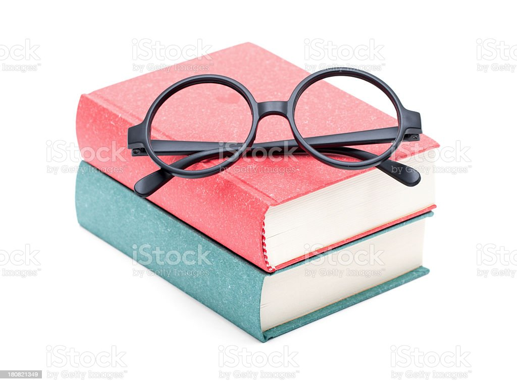 Books and glasses isolated on white background royalty-free stock photo