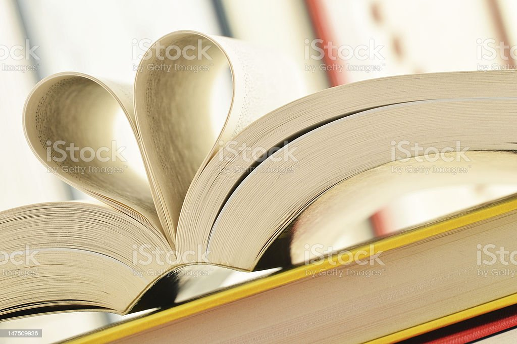 Books and pages formed in a shape of heart royalty-free stock photo