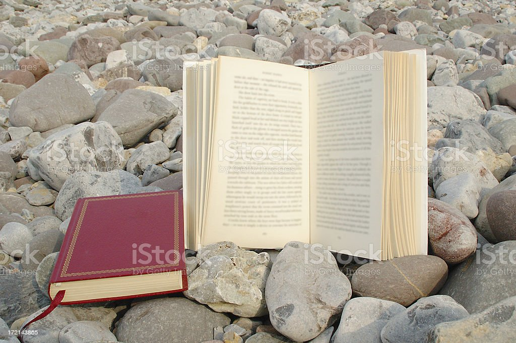 books and pebbles stock photo