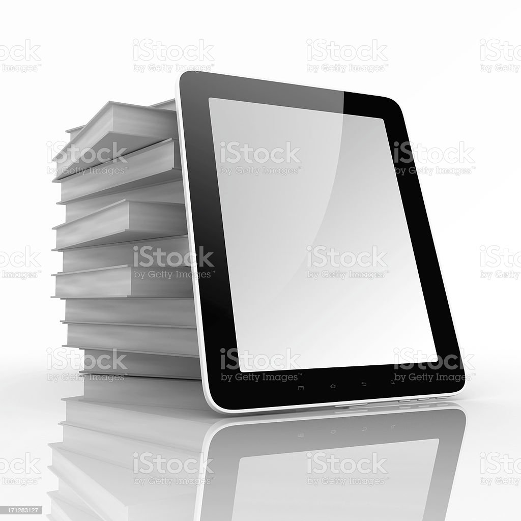 Books and tablet computer stock photo
