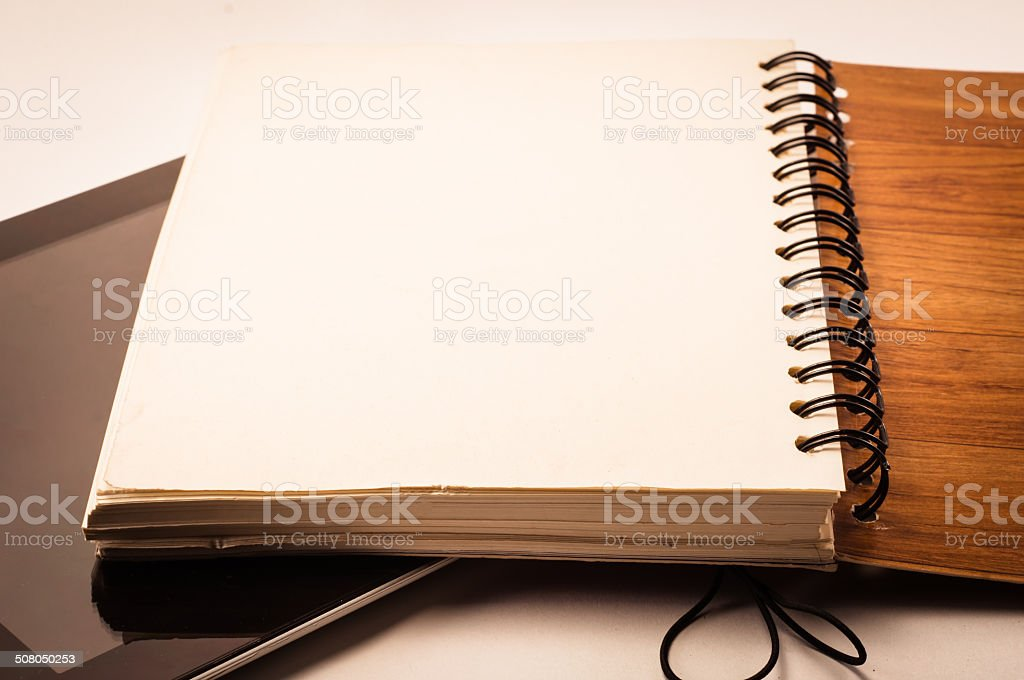 books and tablet stock photo