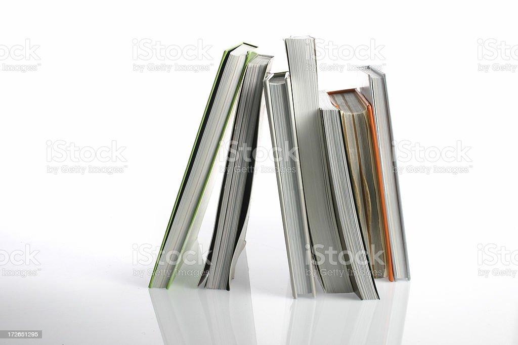 Books balancing vertically royalty-free stock photo
